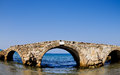 Ruined bridge in the sea zakynthos greece once upon a time this linked two river banks now after coastline change it is situated Stock Photography