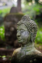 Ruined buddha statue in the jungle area of thailand s temple Stock Images