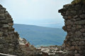 Ruined castle walls hungarian landscape viewed through a gap in Stock Photo