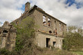 Ruined house a and abandoned roofless and becoming overgrown Royalty Free Stock Photos