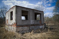 Ruined house desolate dry grass Stock Image