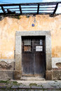Ruined house door in antigua guatemala and wall Royalty Free Stock Photo