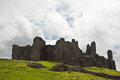 Ruined medieval castle landscape with dramatic sky Stock Photo
