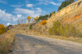 Ruined rural road in central Ukraine at fall season Royalty Free Stock Photo