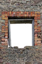 Ruined rustic limestone boulder rubble wall masonry stonework ruins and empty blank isolated red brick window frame aperture Royalty Free Stock Photo