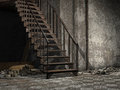 Ruined stairs in an old building with rubble and bones Stock Photography