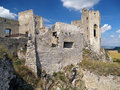 Ruined walls and chapel of beckov castle fortification remains during summer this is located in village slovakia Royalty Free Stock Photo