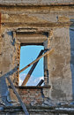 Ruined window in a abandoned building Stock Photography