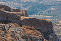 Ruins of ancient fortress the an old in corinth on a slope a high mountain Stock Photography