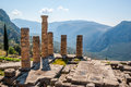 Ruins of an ancient temple and columns greek in front the surrounding mountains Royalty Free Stock Photography