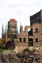Ruins of gdansk granary against st mary s church in poland Stock Images