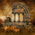 Ruins with halloween pumpkins on a meadow candles and Royalty Free Stock Image