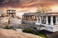 Ruins in hampi ancient of vijayanagara empire at sunset sky karnataka india Stock Image