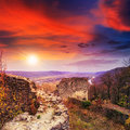 Ruins of an old castle in the mountains at sunset stone wall ruined Stock Photo