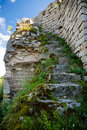 Ruins of spiral staircase with foliage of damaged tower in Ivang Royalty Free Stock Photo