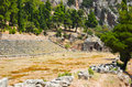 Ruins of stadium in delphi greece archaeology background Stock Image