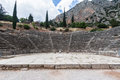 The ruins of the theatre with its stairs and stage in delphi greece Royalty Free Stock Photos