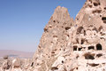 Ruins of uchisar cave dwellings and castle in turkey Royalty Free Stock Photo
