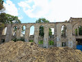 Ruins of walls of medieval castle with vegetation grown Stock Photography