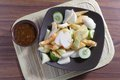 Rujak traditional fruit salad dish at wooden table Royalty Free Stock Photo