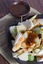 Rujak traditional fruit salad dish at wooden table Royalty Free Stock Photos