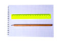 Ruler and pencil on notebook isolated on white background Royalty Free Stock Photo