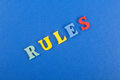 RULES word on blue background composed from colorful abc alphabet block wooden letters, copy space for ad text. Learning Royalty Free Stock Photo