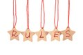 Rules word spelled with paper stars are hung by ropes isolated against white background Stock Image