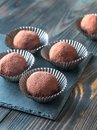 Rum balls on the black stone board Royalty Free Stock Photo