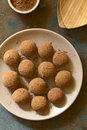 Rum balls covered with cocoa powder photographed overhead on slate with natural light selective focus focus on the top of the Royalty Free Stock Images