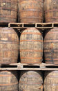 Rum barrels a stack of wooden mature in a factory in the carribean Stock Photography
