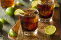 Rum and cola cuba libre with lime ice Royalty Free Stock Photo