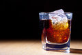 Rum and cola in glass with ice Stock Photos