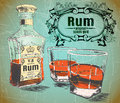 Rum was pour in two glasses with bottle on shabby background vintage victorian frame and text original spiced gold retro Stock Photography