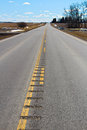 Rumble strips engraved into a secondary highway Royalty Free Stock Photo
