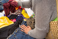 Rummaging in clothes at a jumble sale Royalty Free Stock Images