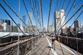 Run on brooklyn bridge new york city usa august tourists and new yorkers across the every day for sports sightseeing or simply to Royalty Free Stock Image