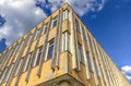 Run down building with blue sky hdr and clouds Royalty Free Stock Images
