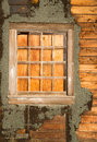 Run down ruin boarded up house plywood window panes a structure photographed from the outsdie has been from the inside Royalty Free Stock Photo