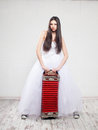 Runaway bride with russian accordion sneakers wedding Royalty Free Stock Photo