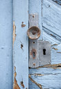 Rundown blue door detail of a old wooden with flaking paint Stock Image
