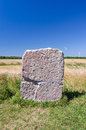 Rune stone on oland island ancient with modern wind turbines in background Royalty Free Stock Photos