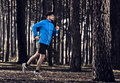 Runing in the forest athletic man doing exercise running Stock Images