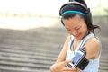 Runner athlete listening to music in headphones fr