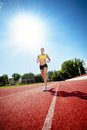 Runner on athletic track Stock Photos