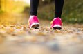 Runner close up of feet of a running in autumn leaves training exercise Royalty Free Stock Image