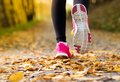 Runner close up of feet of a running in autumn leaves training exercise Stock Images