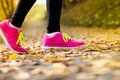 Runner close up of feet of a running in autumn leaves training exercise Royalty Free Stock Images