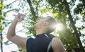 Runner cooling down after running young man is refreshing with water training Stock Images