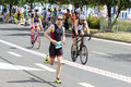 Runner and cyclists during first triathlon szczecin race poland july Royalty Free Stock Image